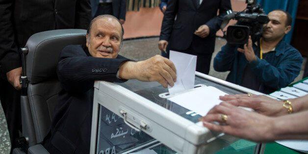 Algeria's President Abdelaziz Bouteflika casts his ballot during the presidential election in Algiers...