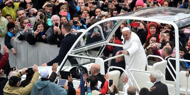 Pope Francis greets the crowd from the popemobile after the Easter Mass at St Peter's square on April...