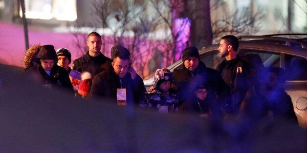 REFILE - ADDITIONAL INFORMATIONPeople leave a mosque after a shooting in Quebec City, Canada, January...