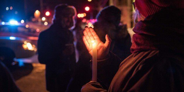 People come to show their support after a shooting occurred in a mosque at the Québec City Islamic cultural...