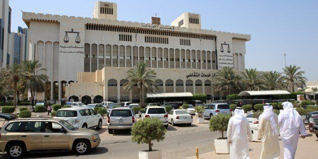 Kuwaitis arrive at the Palace of Justice where the sentence hearing of 29 defendants for their roles...