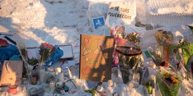 Messages and flowers are placed near a mosque that was the location of a shooting spree in Quebec City,...