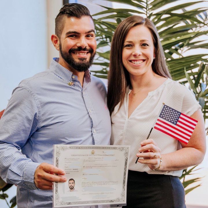 Tiago and the author on the day he was naturalized as a U.S. citizen.