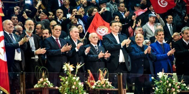 Secretary general of the General Union of Tunisian Workers (UGTT), Houcine Abbassi (5th from L), and...