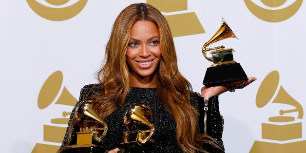 Beyonce holds the awards she won for Best R&B Performance and Best R&B Song