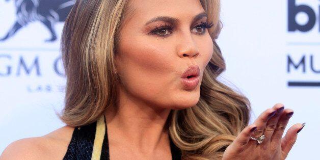 Model Chrissy Teigen blows as kiss as she arrives at the 2015 Billboard Music Awards in Las Vegas, Nevada...