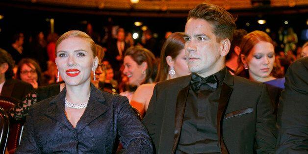 U.S. actress Scarlett Johansson and her partner Romain Dauriac attend the 39th Cesar Awards ceremony...