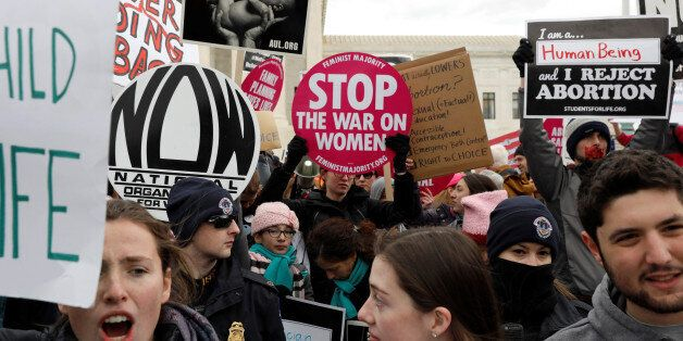 Pro-life activists gather outside the Supreme Court for the National March for Life rally in Washington,...