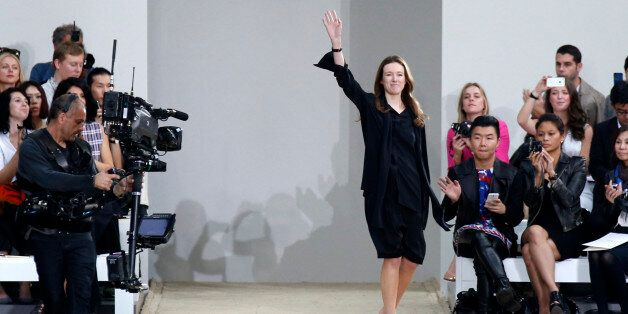 British-born designer Clare Waight Keller appears on the runway after presenting her Spring/Summer 2014...
