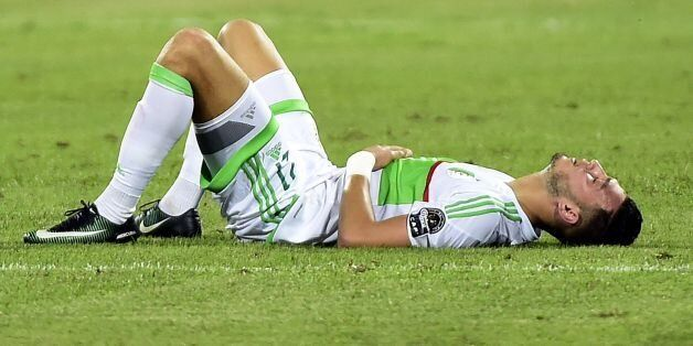Algeria's defender Rami Bensebaini reacts at the end of the 2017 Africa Cup of Nations group B football...