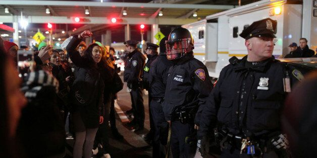 Protesters gather outside Terminal 4 at JFK airport in opposition to U.S. president Donald Trump's proposed...