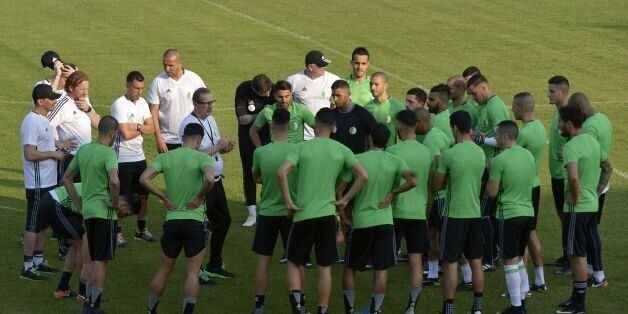 Algeria's Belgian Coach Georges Leekens (C-L) addresses players during a training session in Moanda on...