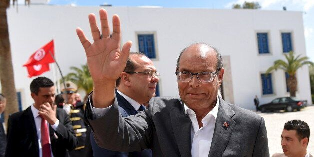 Former Tunisian president Moncef Marzouki arrives to take part in an anti-extremism march in Tunis March...