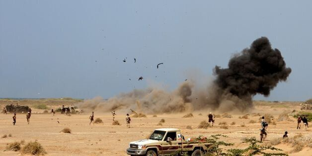 A landmine explodes as Yemeni loyalist forces patrol an area near the Red Sea port town of Mocha on January...