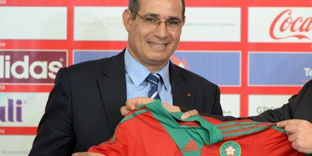 Morocco's Atlas Lions newly appointed coach Badou Zaki poses with the national jersey on May 2, 2014...