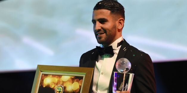 Algerian and Leicester forward Riyad Mahrez poses for a photo after being crowned African Footballer...