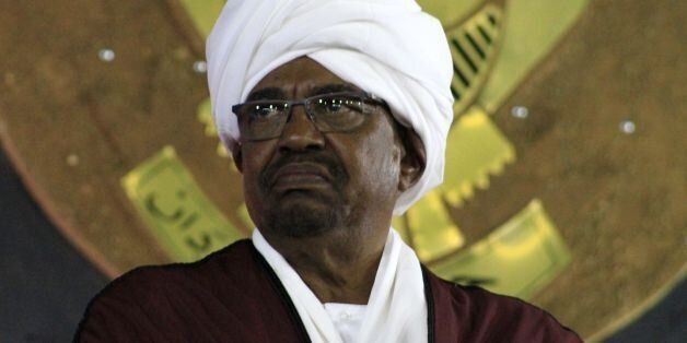Sudanese President Omar al-Bashir (C) looks on during a celebration to mark the 61st anniversary of Sudans...