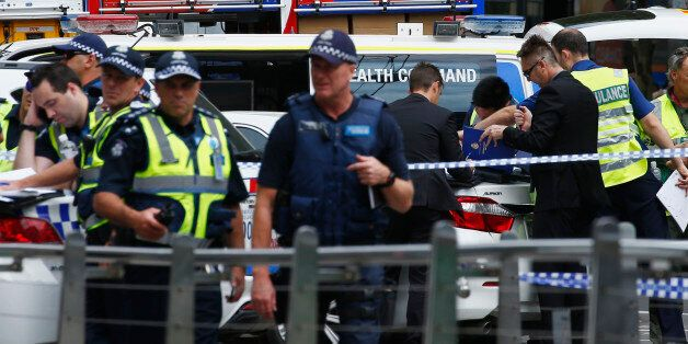 Police and emergency services personnel are seen after police cordoned off Bourke Street mal, after a...
