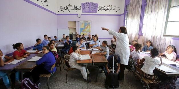 Schoolchildren listen to a teacher as they study during a class in the Oudaya primary school in Rabat,...