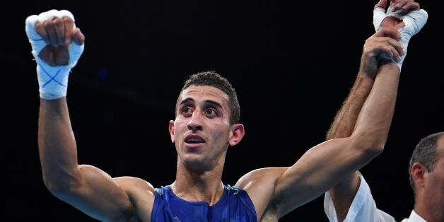 Algeria's Mohamed Flissi reacts after winning against Bulgaria's Daniel during the Men's Fly (52kg) match...