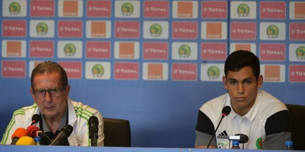 Algeria's Belgian Coach Georges Leekens and player Aissa Mandi give a press conference at Franceville...