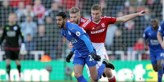 Leicester City's Riyad Mahrez (left) and Middlesbrough's Ben Gibson (right) battle for the ball during...