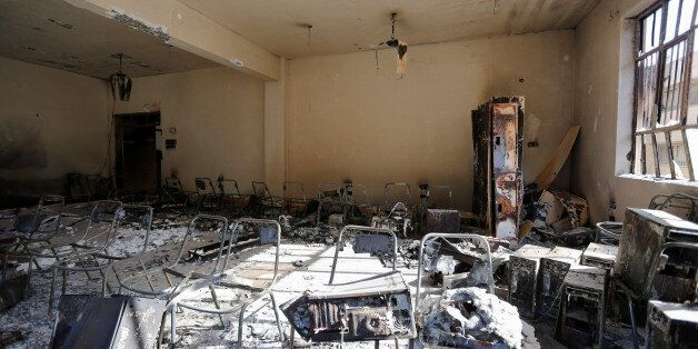 The interior of a burnt building of the University of Mosul is seen during a battle with Islamic State...
