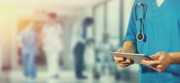 Concept of global medicine and healthcare. Doctor holds digital tablet. Diagnostics and modern