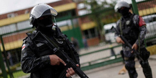 Soldiers of the military police are seen during a security operation outside of Puraquequara prison in...