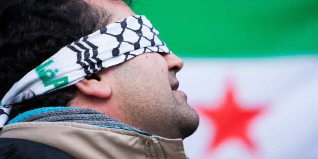 PIAZZA DI SAN MARCO, ROME, ITALY - 2015/01/31: Presidio of solidarity with political prisoners in Syria...