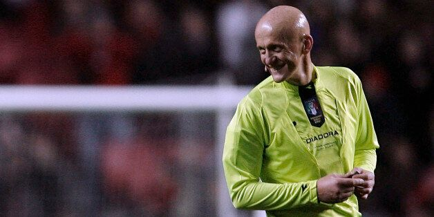 Former FIFA soccer referee Pierluigi Collina of Italy smiles during the