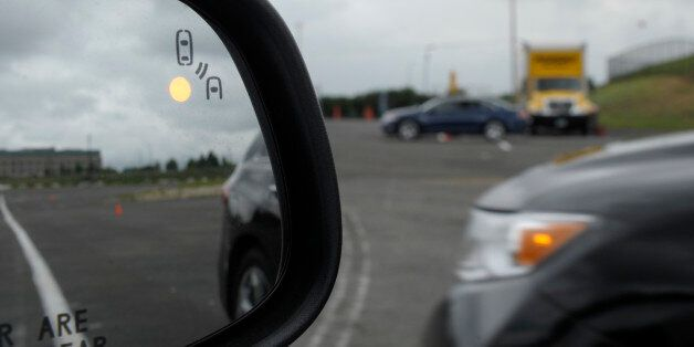 In this photo taken, Tuesday, May 22, 2012, professional test driver J.D. Ellis of Cincinnati, Ohio,...