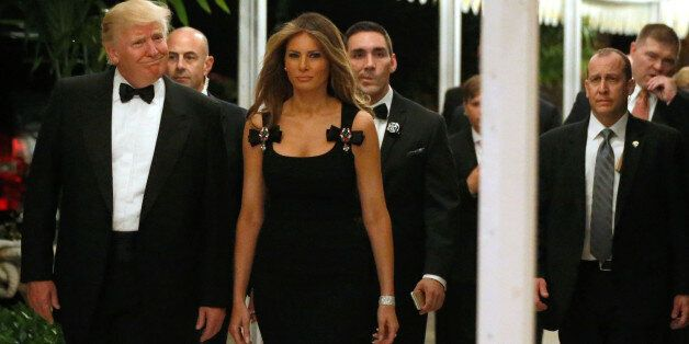U.S. President-elect Donald Trump and his wife Melania Trump arrive for a New Year's Eve celebration...