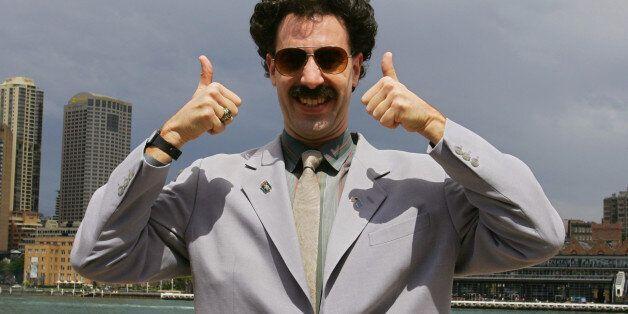 British actor Sacha Baron Cohen, acting as Kazakh TV reporter known as 'Borat', poses for photographers...