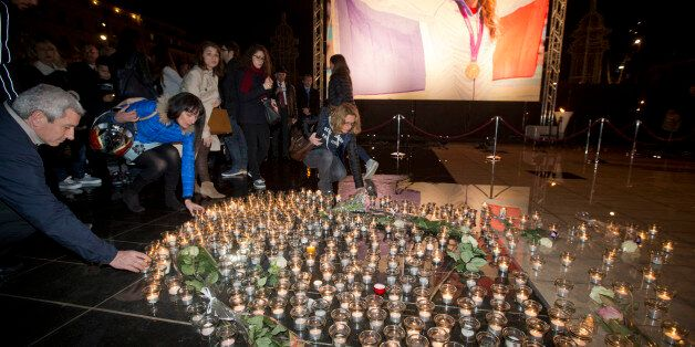 People put candles as they pay homage to Olympic gold medalist swimmer Camille Muffat, Tuesday, March,...