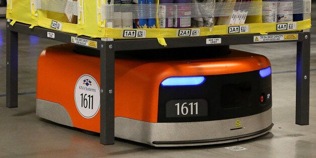 TRACY, CA - JANUARY 20: A Kiva robot moves a rack of merchandise at an Amazon fulfillment center on January...
