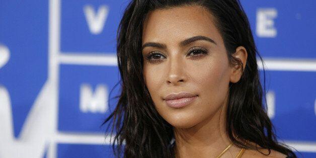 FILE PHOTO: Kim Kardashian arrives at the 2016 MTV Video Music Awards in New York, U.S., August 28, 2016....
