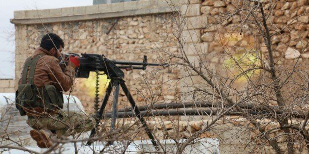 ALEPPO, SYRIA - JANUARY 14: A Free Syrian Army member attacks to Daesh positions during the 'Operation...
