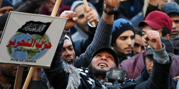 Tunisian protesters shoot slogans during a demonstration called by the supporters of radical Islamist...
