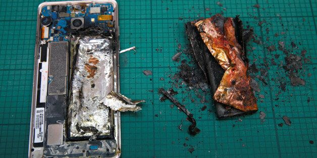 THIS IMAGE HAS BEEN BINNED. A Samsung Note 7 handset is pictured next to its charred battery after catching...