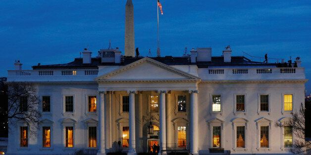 Security personnel walk on the roof of then White House near Pennsylvania Avenue before Inauguration...