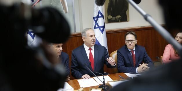 Israeli Prime Minister Benjamin Netanyahu (C) attends the weekly cabinet meeting in Jerusalem on January...