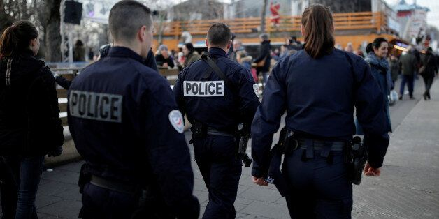 French police officers patrol a Christmas market on the Champs Elysees Avenue as emergency security measures...