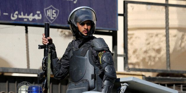 A security forces member is seen outside the State Council courthouse after a ruling against the Egypt-Saudi...