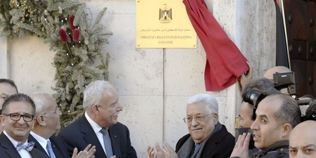 Palestinian president Mahmud Abbas (C, R) applauds after he inaugurated the new Palestinian diplomatic...