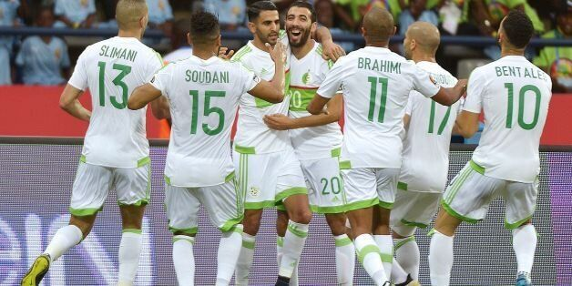 Algeria's forward Riyad Mahrez (back C) celebrates with teammates after scoring a goal during the 2017...