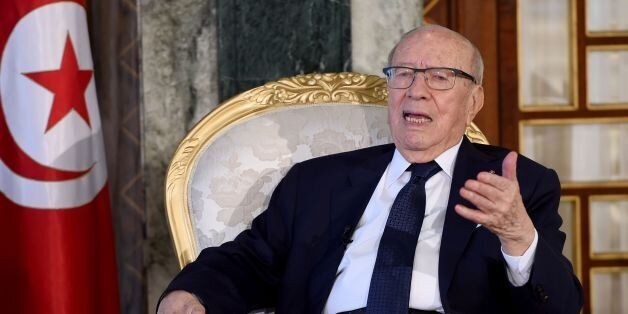 Tunisian President Beji Caid Essebsi answers questions during his meeting with French students of political...