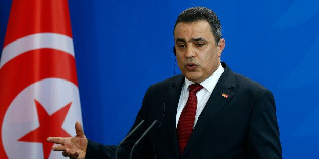 Tunisia's Prime Minister Mehdi Jomaa speaks during a news conference after talks with German Chancellor...