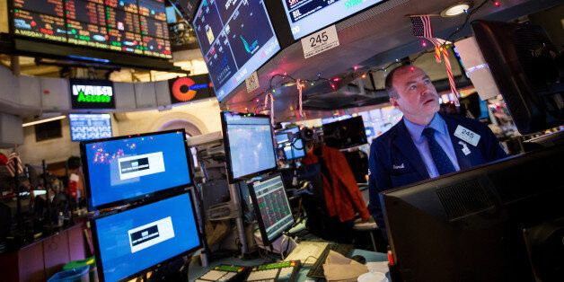 A trader works on the floor of the New York Stock Exchange (NYSE) in New York, U.S., on Monday, Dec....