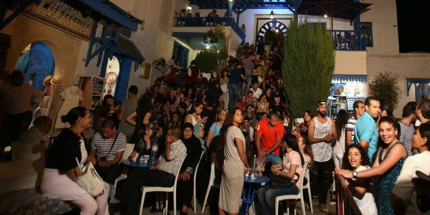 People are seen in a coffee shop during the Muslim fasting month of Ramadan at Sidi Bou Said in Tunis,...